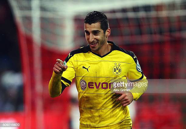 Henrikh Mkhitaryan of Borussia Dortmund celebrates as he scores their third goal during the DFB Cup Quarter Final match between VfB Stuttgart and...