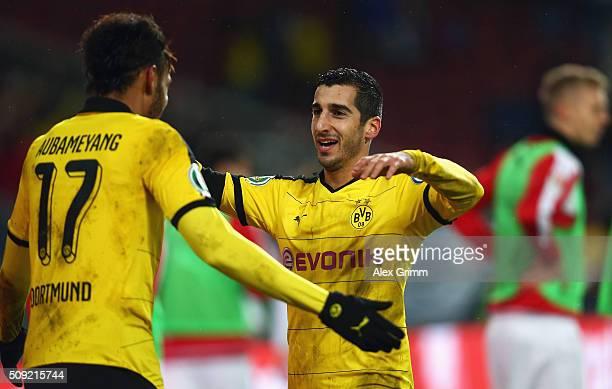Henrikh Mkhitaryan of Borussia Dortmund celebrates with PierreEmerick Aubameyang as he scores their third goal during the DFB Cup Quarter Final match...