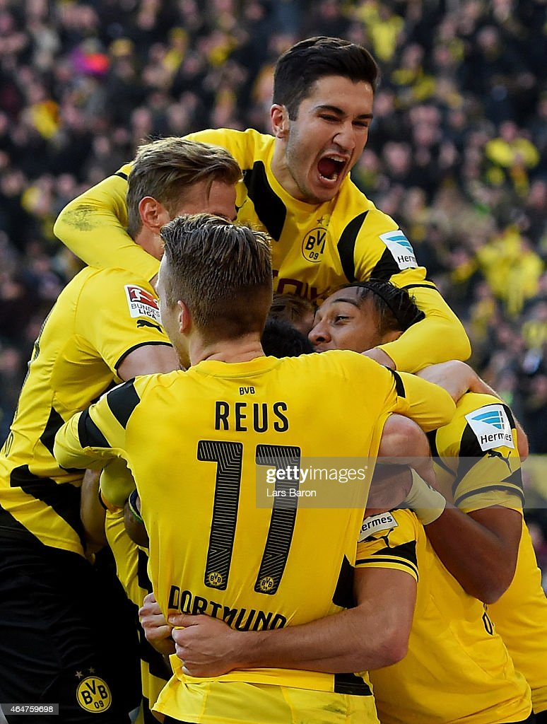 Henrikh Mkhitaryan of Borussia Dortmund celebrates with team mates after scoring his teams second goal during hte Bundesliga match between Borussia Dortmund and FC Schalke 04 at Signal Iduna Park on February 28, 2015 in Dortmund, Germany.