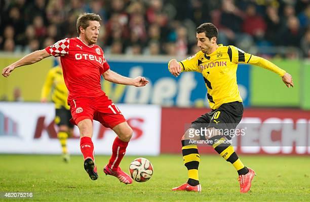 Henrikh Mkhitaryan of Borussia Dortmund challenges Andreas Lambertz of Duesseldorf during a friendly match between Borussia Dortmund against Fortuna...