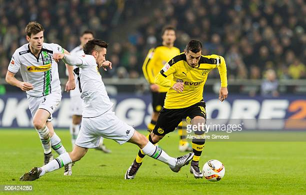Henrikh Mkhitaryan of Borussia Dortmund gets challenged by Julian Korb of Moenchengladbach during the Bundesliga match between Borussia...