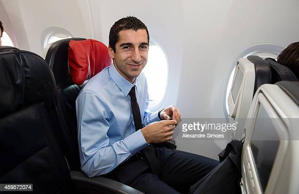 Henrikh Mkhitaryan of Borussia Dortmund in the airplane at the Dortmund airport prior to their UEFA Champions League match against FC Arsenal at...