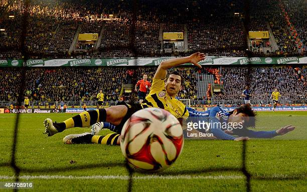Henrikh Mkhitaryan of Borussia Dortmund scores his teams second goal next to Atsuto Uchida of Schalke 04 during hte Bundesliga match between Borussia...