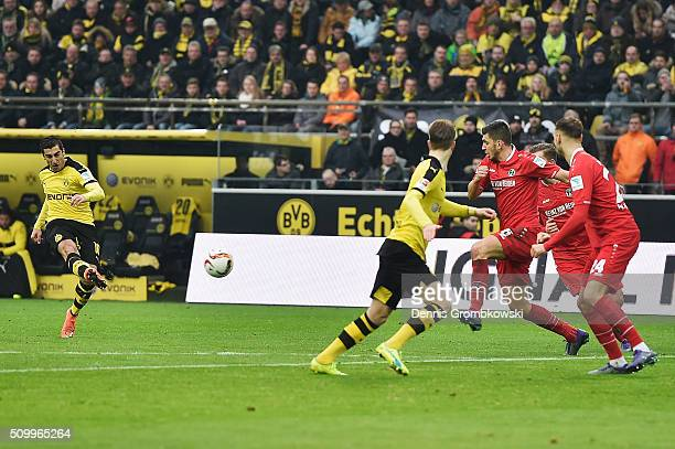 Henrikh Mkhitaryan of Borussia Dortmund scores the opening goal during the Bundesliga match between Borussia Dortmund and Hannover 96 at Signal Iduna...