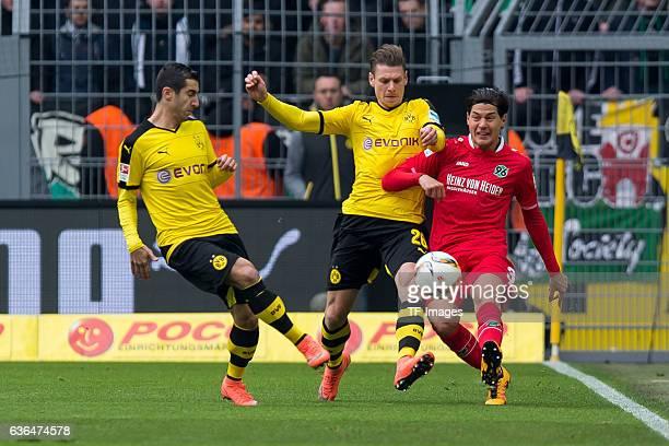 Henrikh Mkhitaryan of Bosussia Dortmund , Lukasz Piszczek of Bosussia Dortmund and Miiko ALBORNOZ of Hannover 96 battle for the ball during the...
