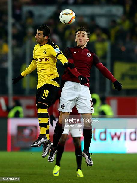 Henrikh Mkhitaryan of Dortmund and Josef Sural of Prague jump to head for the ball during the friendly match between Borussia Dortmund and Sparta...