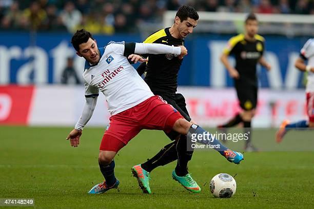 Henrikh Mkhitaryan of Dortmund and Tolgay Arslan of Hamburg compete for the ball during the Bundesliga match between Hamburger SV and Borussia...