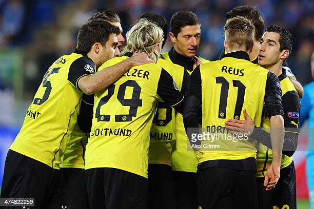 Henrikh Mkhitaryan of Dortmund celebrates his team's first goal with team mates during the UEFA Champions League Round of 16 match between FC Zenit...