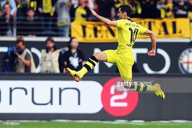 Henrikh Mkhitaryan of Dortmund celebrates his team's second goal during the Bundesliga match between Eintracht Frankfurt and Borussia Dortmund at...