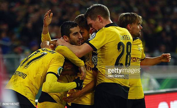 Henrikh Mkhitaryan of Dortmund celebrates his team's third goal with team mates during the DFB Cup Quarter Final match between VfB Stuttgart and...