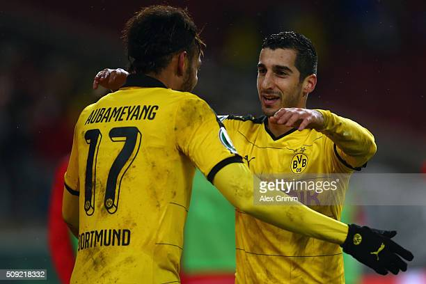 Henrikh Mkhitaryan of Dortmund celebrates his team's third goal with team mate PierreEmerick Aubameyang during the DFB Cup Quarter Final match...