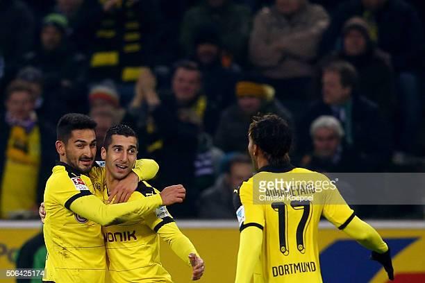 Henrikh Mkhitaryan of Dortmund celebrates the second goal with Ilkay Guendogan and PierreEmerick Aubameyang of Dortmund during the Bundesliga match...