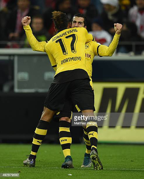Henrikh Mkhitaryan of Dortmund celebrates with his teammate PierreEmerick Aubameyang of Dortmund scoring his team's second goal during the Bundesliga...