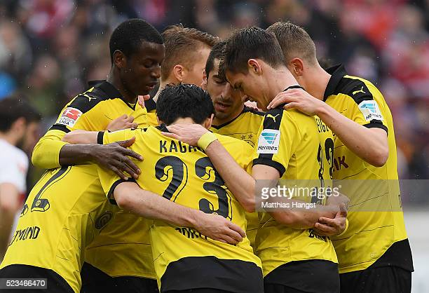 Henrikh Mkhitaryan of Dortmund celebrates with his teammates after scoring his team's third goal during the Bundesliga match between VfB Stuttgart...