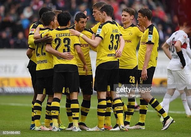 Henrikh Mkhitaryan of Dortmund celebrates with his teammates after scoring his team's third goal during the Bundesliga match between VfB Stuttgart...