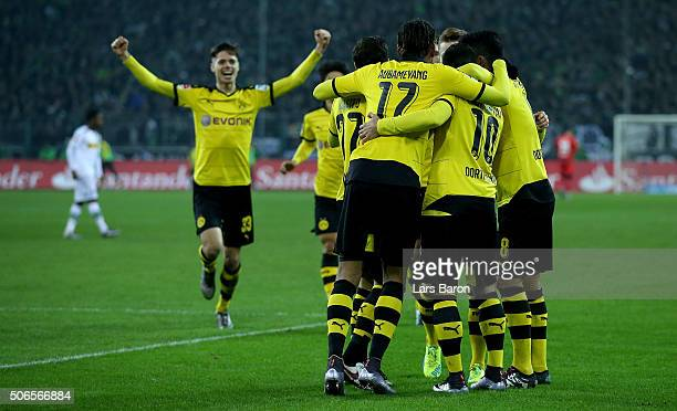 Henrikh Mkhitaryan of Dortmund celebrates with team mates after scoring his teams second goal during the Bundesliga match between Borussia...