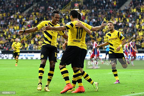 Henrikh Mkhitaryan of Dortmund is congratulated by teammates after scoring the opening goal during the DFL Supercup between Borrussia Dortmund and FC...