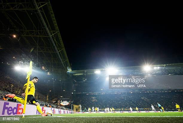 Henrikh Mkhitaryan of Dortmund takes a corner kick during the UEFA Europa League Round of 16 First Leg match between Borussia Dortmund and Tottenham...