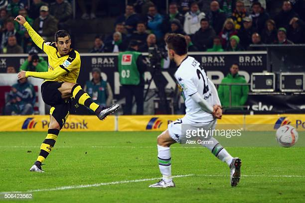 Henrikh Mkhitaryan of Dortmund takes a shot against Julian Korb of Moenchengladbach during the Bundesliga match between Borussia Moenchengladbach and...