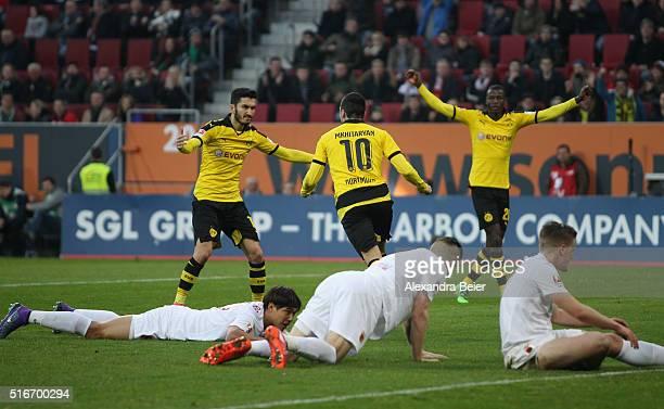 Henrikh Mkhitaryan of Dortmung celebrates his first goal with teammates Nuri Sahin and Ramos Vasquez during the Bundesliga match between FC Augsburg...