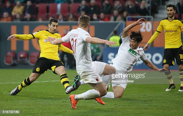 Henrikh Mkhitaryan of Dortmung scores his first goal during the Bundesliga match between FC Augsburg and Borussia Dortmund at SGL Arena on March 20...