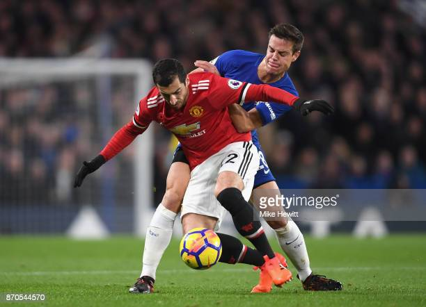 Henrikh Mkhitaryan of Manchester United and Cesar Azpilicueta of Chelsea battle for possession during the Premier League match between Chelsea and...