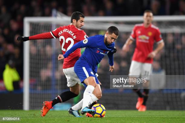 Henrikh Mkhitaryan of Manchester United and Eden Hazard of Chelsea battle for possession during the Premier League match between Chelsea and...