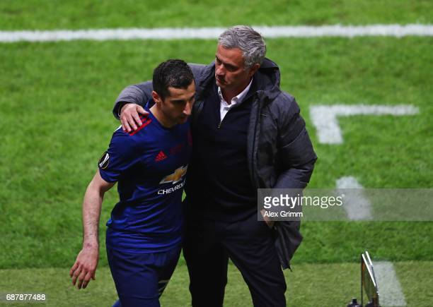 Henrikh Mkhitaryan of Manchester United and Jose Mourinho, Manager of Manchester United embrace after he is subbed during the UEFA Europa League...