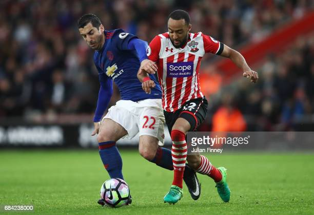 Henrikh Mkhitaryan of Manchester United and Nathan Redmond of Southampton battle for possession during the Premier League match between Southampton...