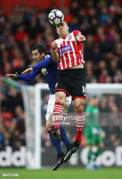 Henrikh Mkhitaryan of Manchester United and Oriol Romeu of Southampto battle for possession during the Premier League match between Southampton and...