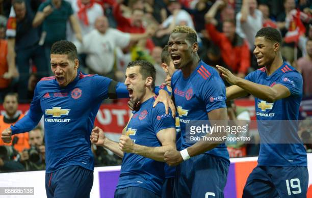 Henrikh Mkhitaryan of Manchester United celebrates after scoring the second goal with teammates Chris Smalling Paul Pogba and Marcus Rashford during...