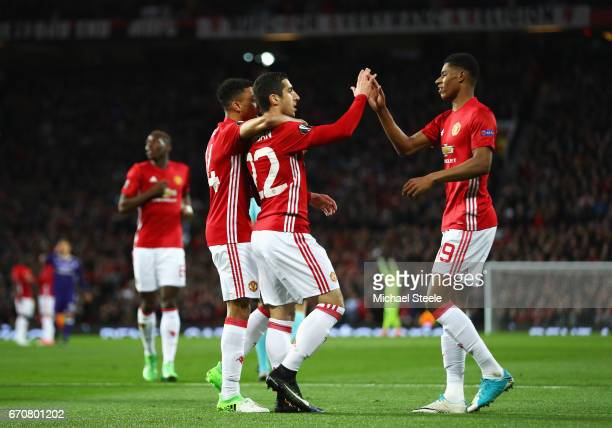 Henrikh Mkhitaryan of Manchester United celebrates as he scores their first goal with Marcus Rashford and Jesse Lingard during the UEFA Europa League...