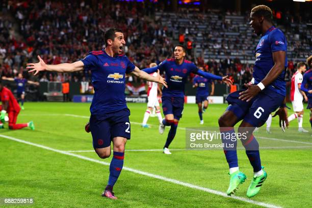 Henrikh Mkhitaryan of Manchester United celebrates scoring his side's second goal with teammate Paul Pogba during the UEFA Europa League Final match...