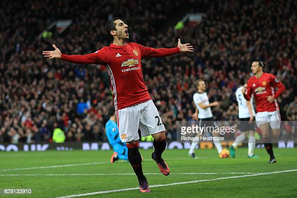 Henrikh Mkhitaryan of Manchester United celebrates scoring the opening goal during the Premier League match between Manchester United and Tottenham...