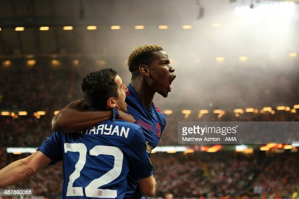 Henrikh Mkhitaryan of Manchester United celebrates scoring the second goal to make the score 02 with teammate Paul Pogba during the UEFA Europa...