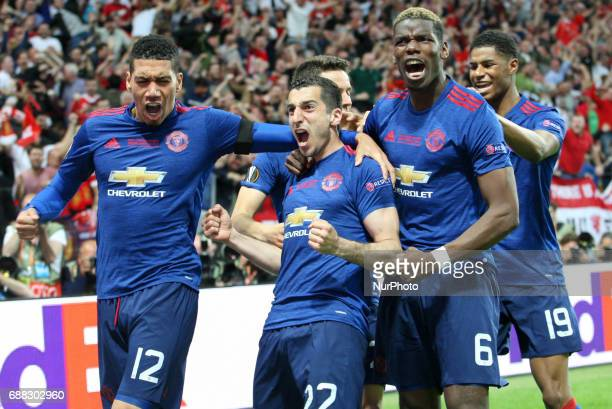 Henrikh Mkhitaryan of Manchester United celebrates scoring the second goal to make the score 02 with teammate Paul Pogba and Chris Smalling during...
