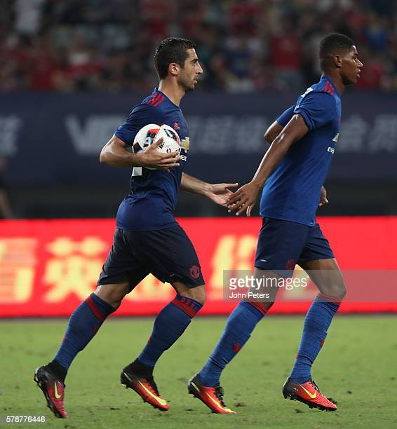 Henrikh Mkhitaryan of Manchester United celebrates scoring their first goal during the preseason friendly match between Manchester United and...