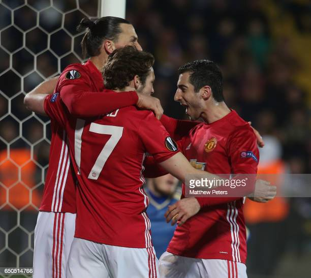 Henrikh Mkhitaryan of Manchester United celebrates scoring their first goal during the UEFA Europa League Round of 16 first leg match between FK...