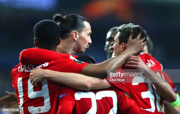 Henrikh Mkhitaryan of Manchester United celebrates with team mates after he scores his sides first goal during the UEFA Europa League quarter final...