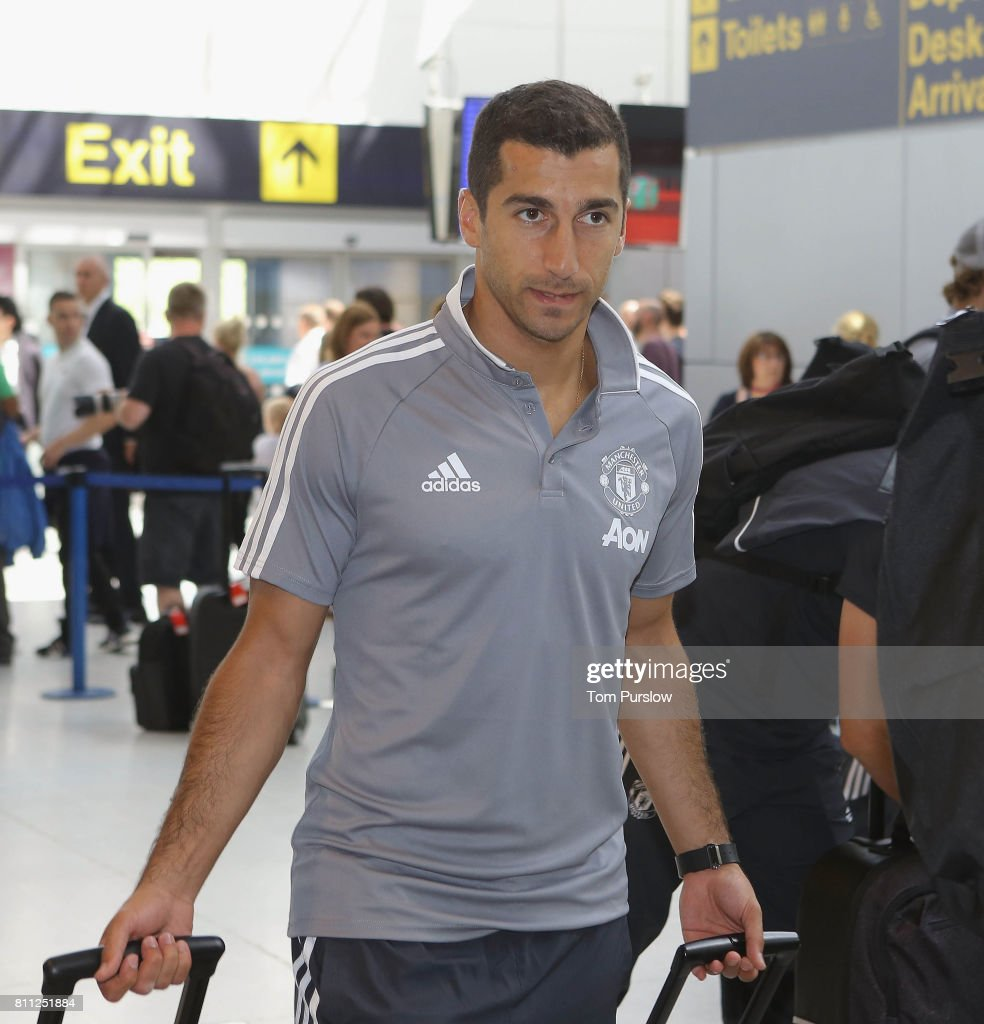 Henrikh Mkhitaryan of Manchester United checks in at Manchester Airport ahead of the club's pre-season tour of the USA at Manchester Airport on July 9, 2017 in Manchester, England.