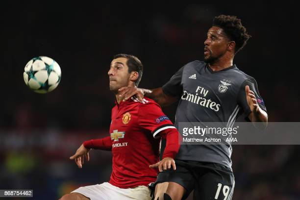 Henrikh Mkhitaryan of Manchester United competes with Eliseu of Benfica during the UEFA Champions League group A match between Manchester United and...