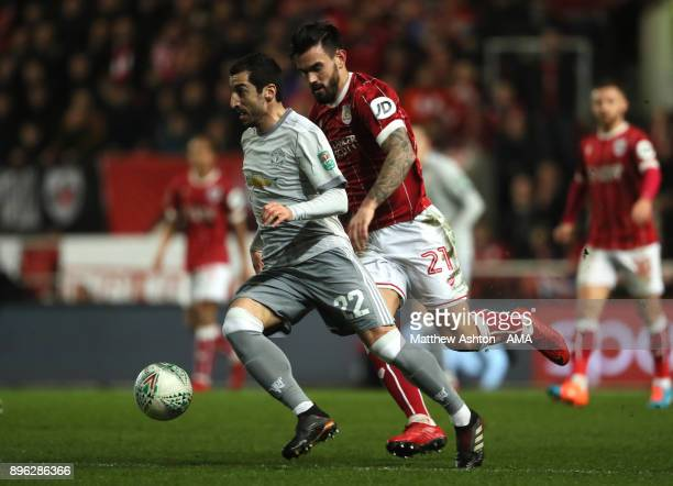Henrikh Mkhitaryan of Manchester United competes with Marlon Pack of Bristol City during the Carabao Cup QuarterFinal match between Bristol City and...