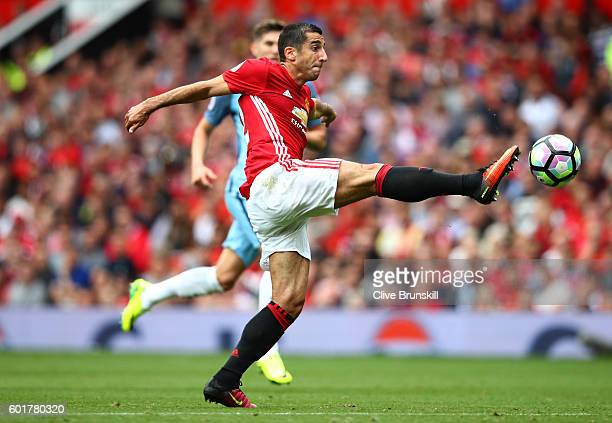Henrikh Mkhitaryan of Manchester United controls the ball during the Premier League match between Manchester United and Manchester City at Old...
