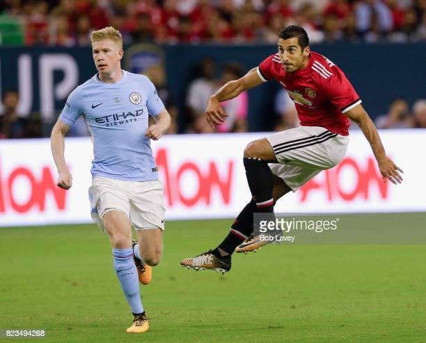 Henrikh Mkhitaryan of Manchester United during game action as Kevin De Bruyne of Manchester City pursues at NRG Stadium on July 20 2017 in Houston...