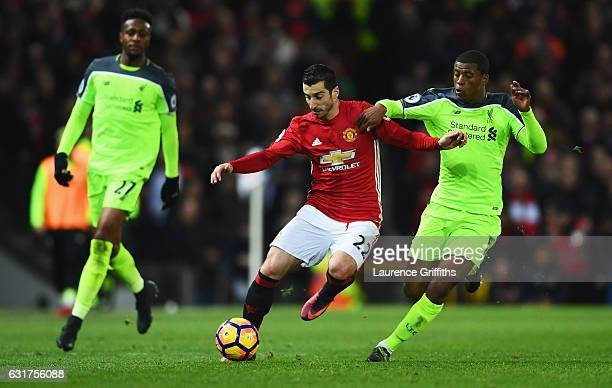 Henrikh Mkhitaryan of Manchester United holds off Georginio Wijnaldum of Liverpool during the Premier League match between Manchester United and...