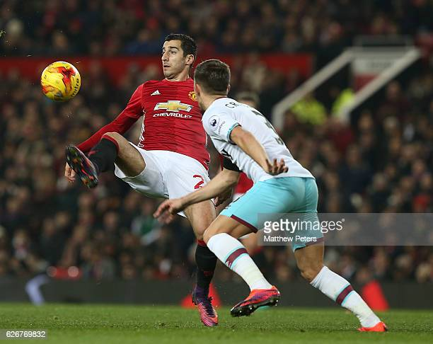 Henrikh Mkhitaryan of Manchester United in action with Aaron Cresswell of West Ham United during the EFL Cup QuarterFinal match between Manchester...