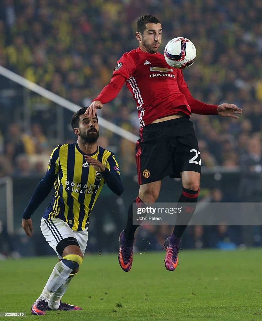 Henrikh Mkhitaryan of Manchester United in action with Alper Potuk of Fenerbahce during the UEFA Europa League match between Manchester United and Fenerbahce at sukru Saracoglu Stadium on November 3, 2016 in Istanbul, Turkey.