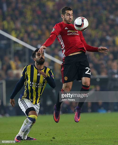 Henrikh Mkhitaryan of Manchester United in action with Alper Potuk of Fenerbahce during the UEFA Europa League match between Manchester United and...