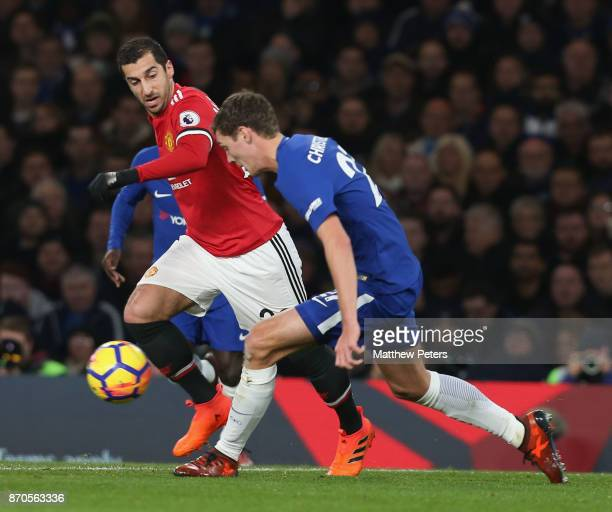 Henrikh Mkhitaryan of Manchester United in action with Andreas Christiensen of Chelsea during the Premier League match between Chelsea and Manchester...