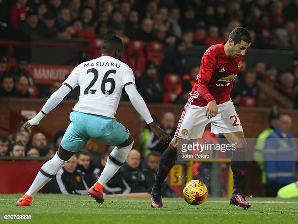Henrikh Mkhitaryan of Manchester United in action with Arthur Masuaku of West Ham United during the EFL Cup QuarterFinal match between Manchester...